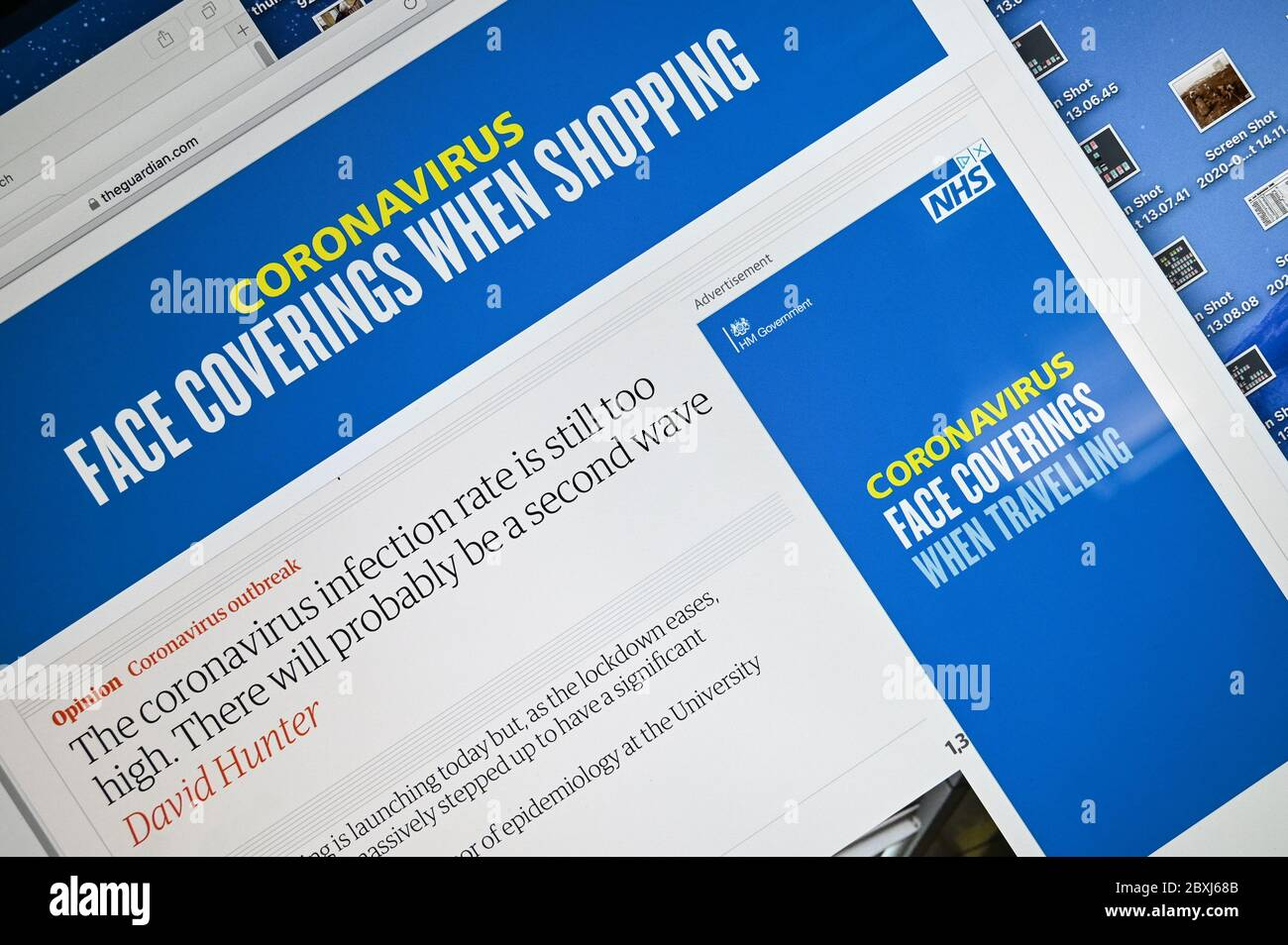 """UK government adverts """"Coronavirus, face coverings when shopping"""" and """"when travelling"""". Stock Photo"""