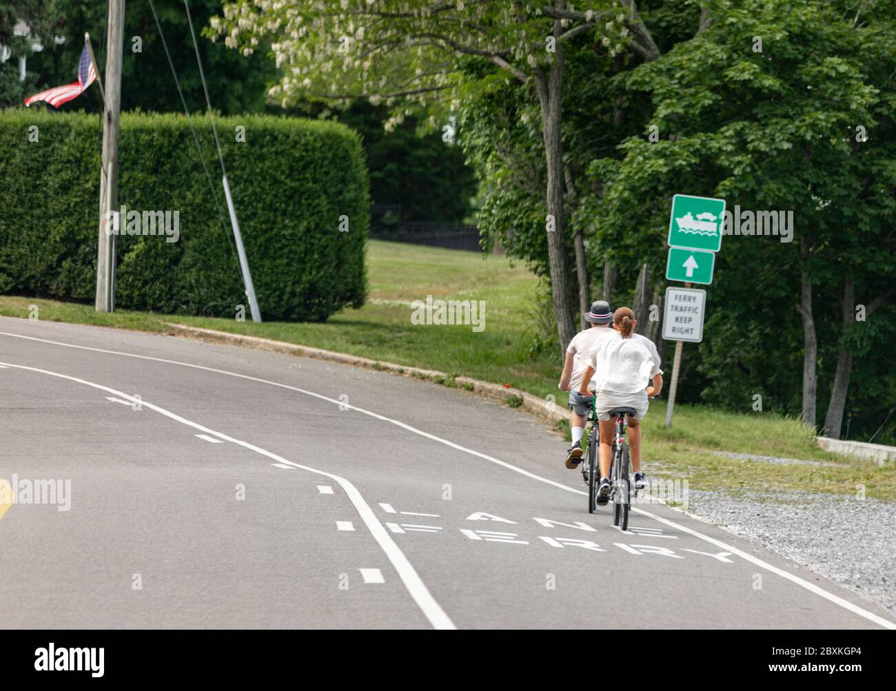 couple riding bike in the Shelter Island Heights, Shelter Island, NY Stock Photo
