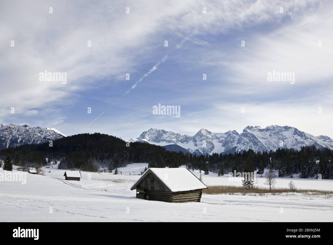 walker at cottage near lake Geroldsee in Winter, bavarian pre-alps Stock Photo