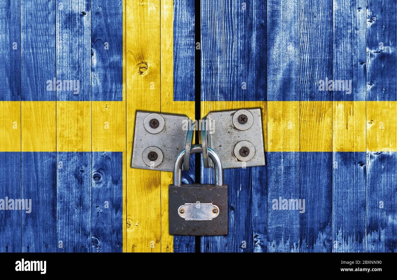 Sweden flag on door with padlock Stock Photo
