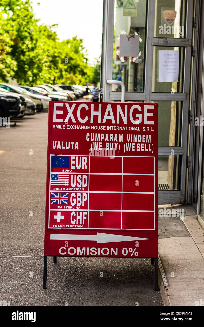 The exchange rate of the main currencies is displayed on a red board at the entrance of a currency exchange office in Bucharest, Romania, 2020 Stock Photo