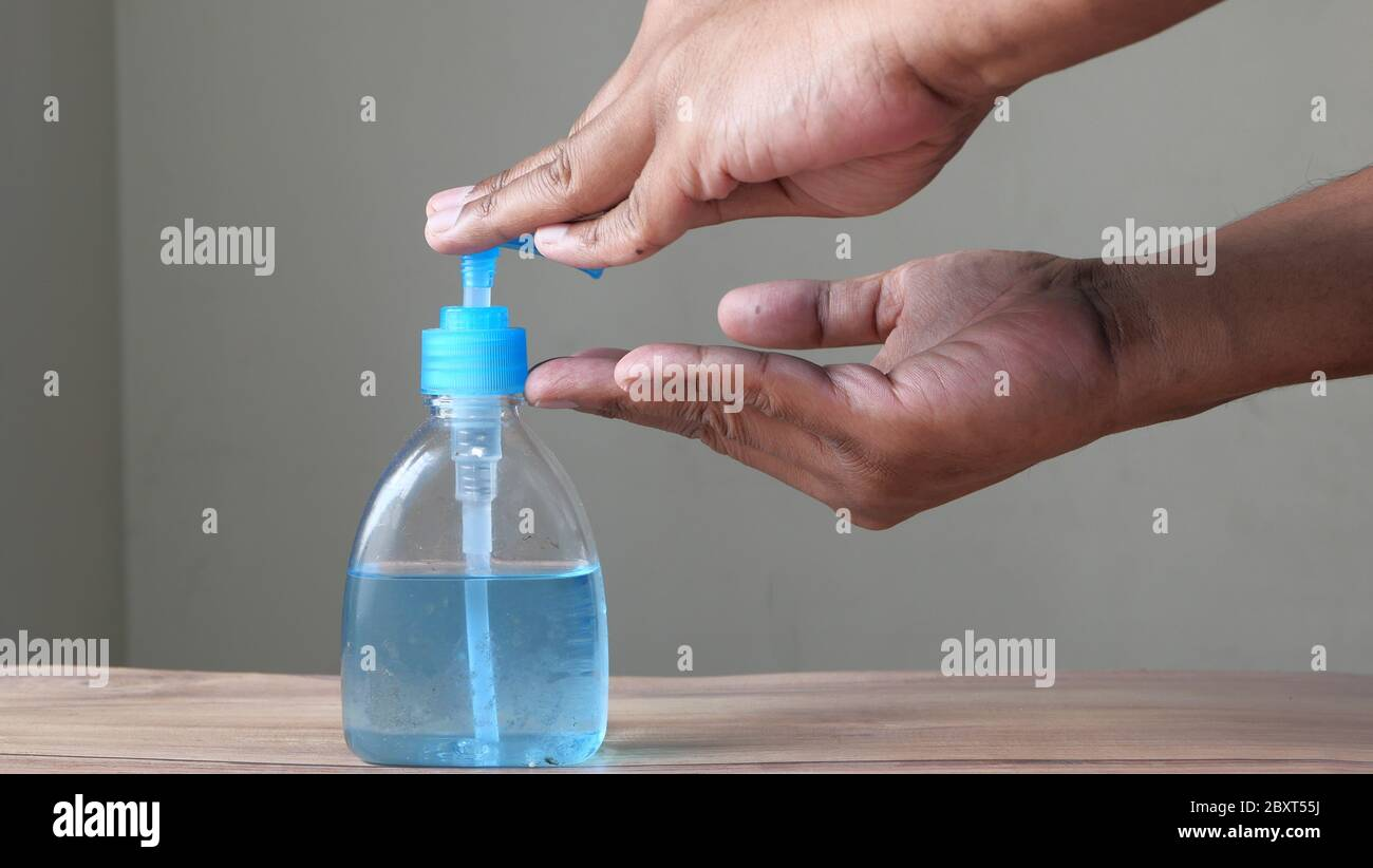 man's hands using hand sanitizer gel, healthcare and medical . Stock Photo