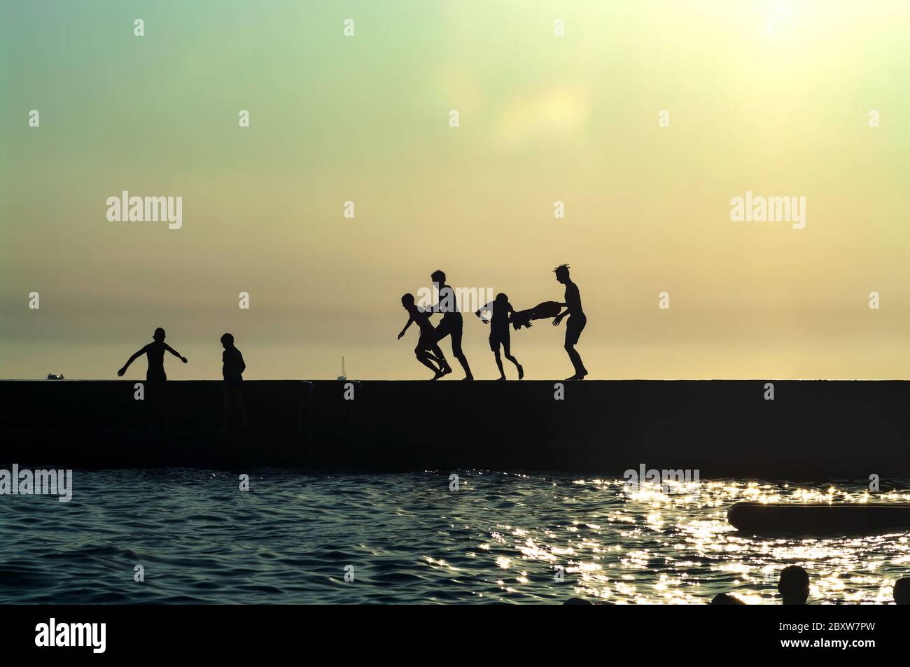Silhouette Photo Of People Resting On The Pier After Sunset Divnomorskoye Krasnodar Krai Russia Stock Photo Alamy