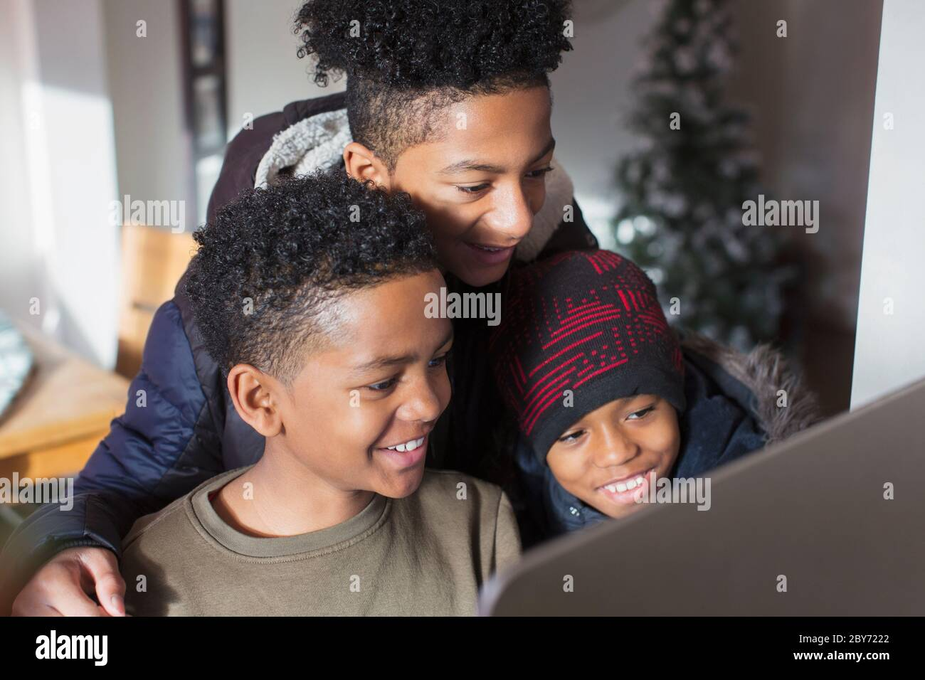 Happy brothers using computer Stock Photo