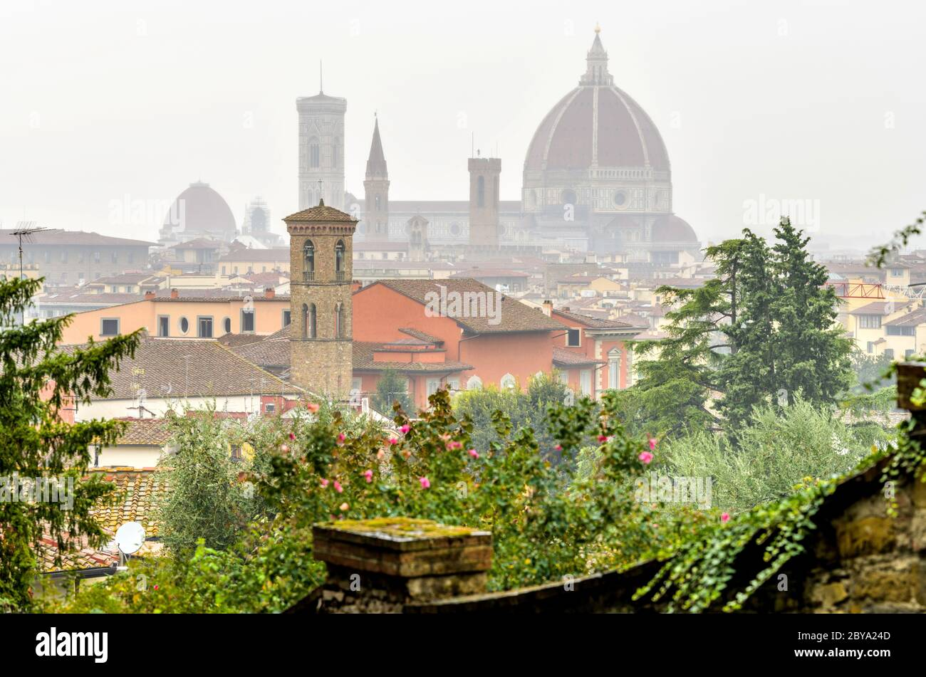 Florence in The Rain - A rainy and foggy Autumn day view of the skyline of Florence Cathedral in the historical Old Town of Florence. Tuscany, Italy. Stock Photo
