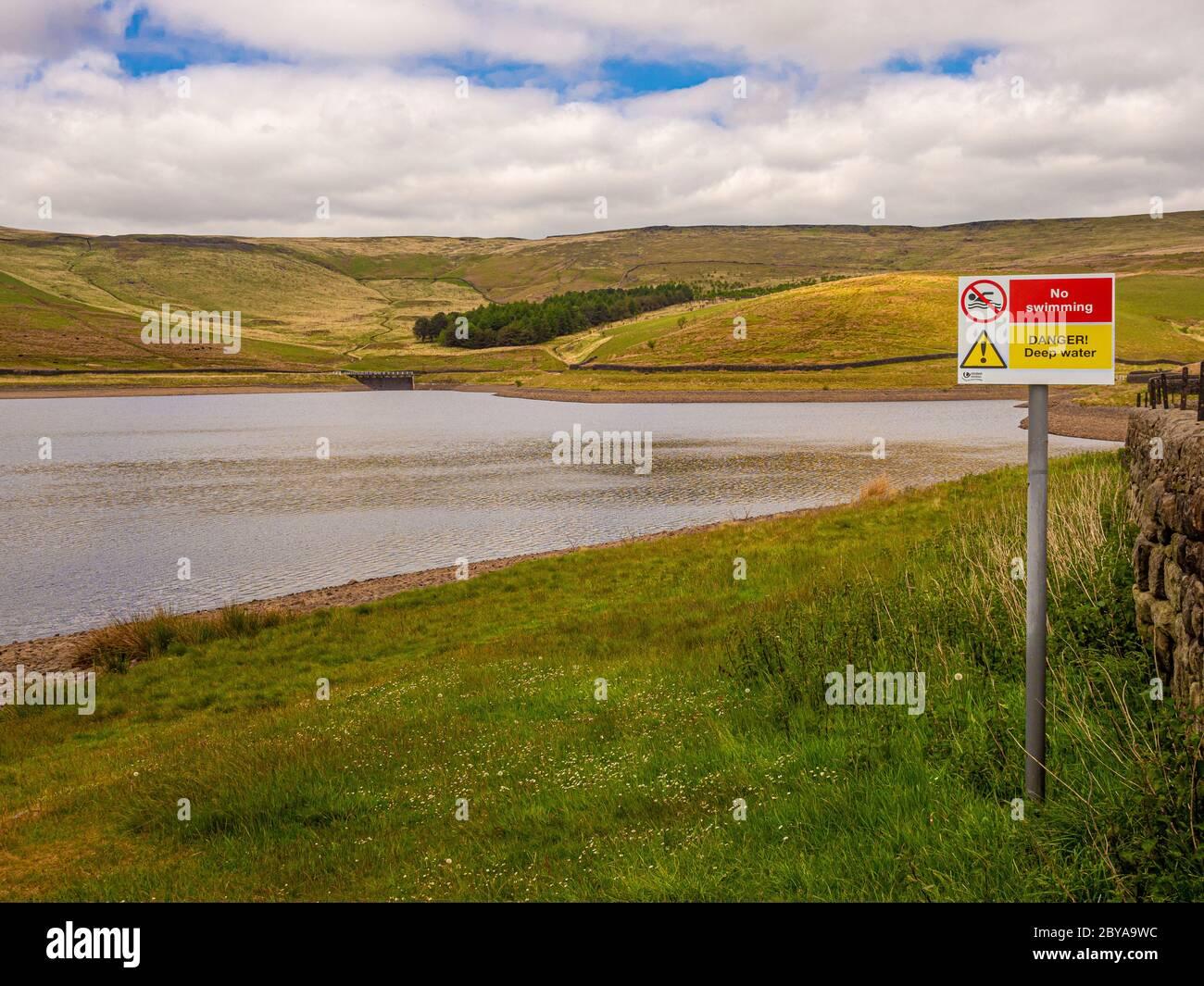 Castleshaw Upper Reservoir. No Swimming, Danger Deep Water sign. Lancashire UK. Stock Photo