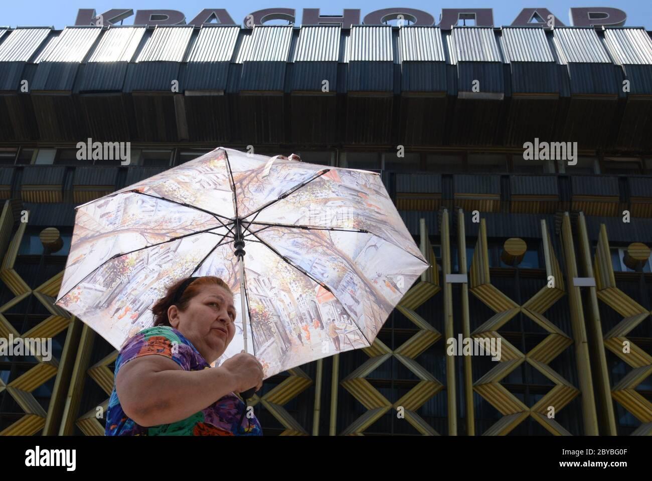 Krasnodar Russia 9th June 2020 A Woman Walks Under An Umbrella In A Street Due To