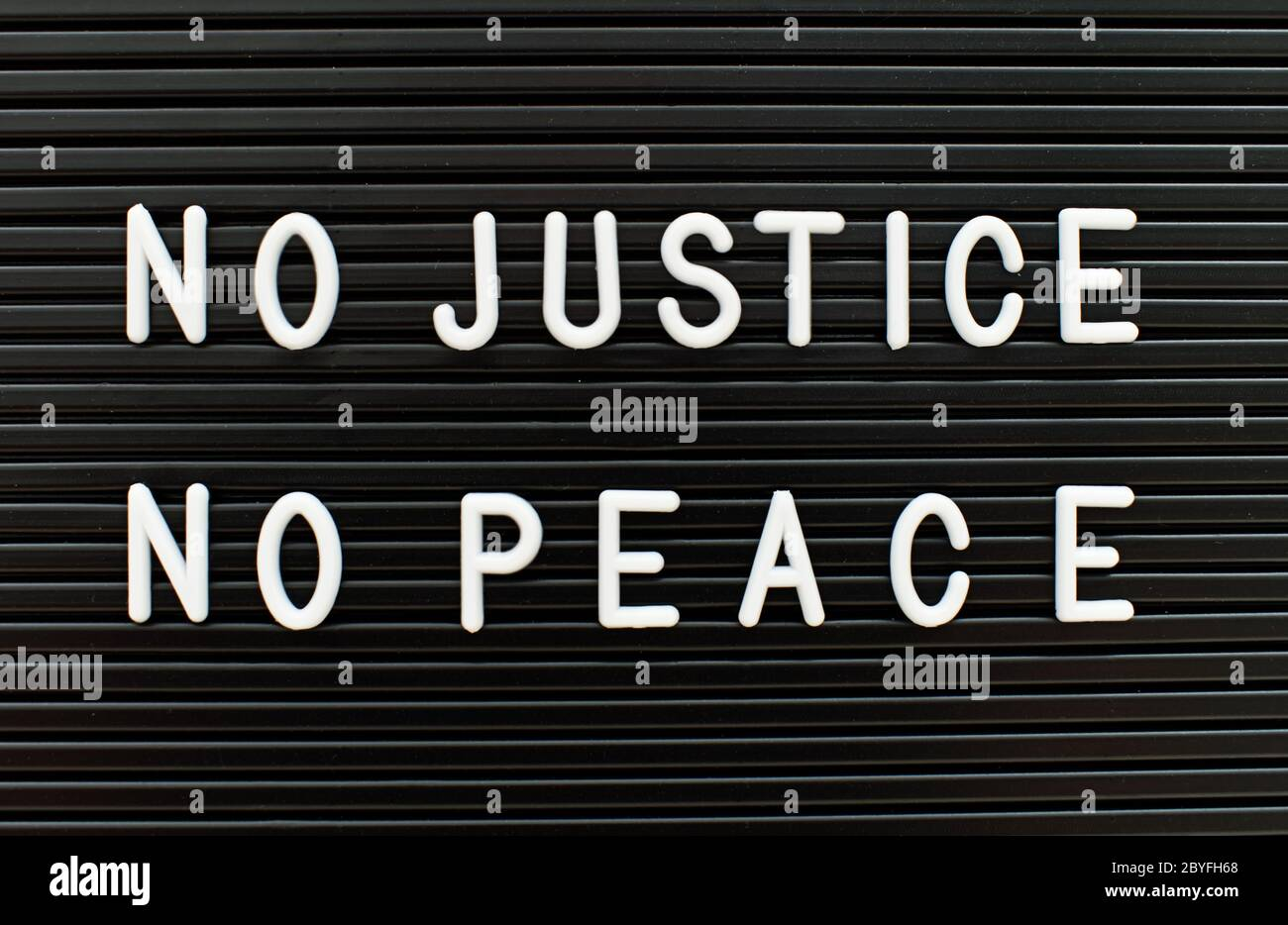 No justice no peace written on letter board. Police brutality concept. Stock Photo