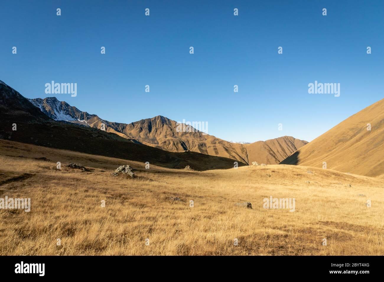 dramatic mountain hiking landscape in Juta trekking area landscape in autumn -  popular trekking  in the Caucasus mountains, Kazbegi region, Georgia. Stock Photo