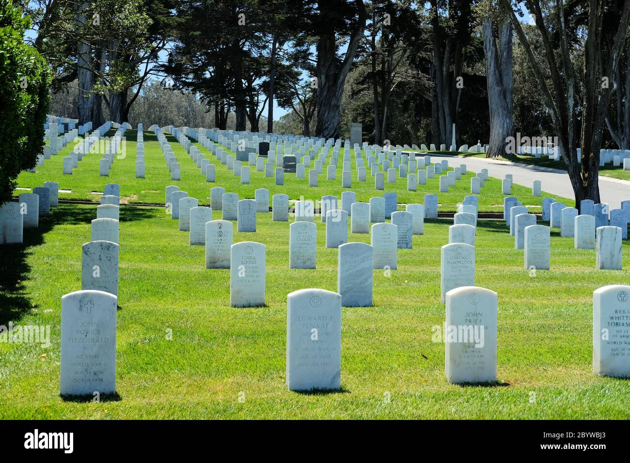 White tombstones rows at the San Francisco National Cemetery, a United States national cemetery, located in the Presidio of San Francisco, California. Stock Photo