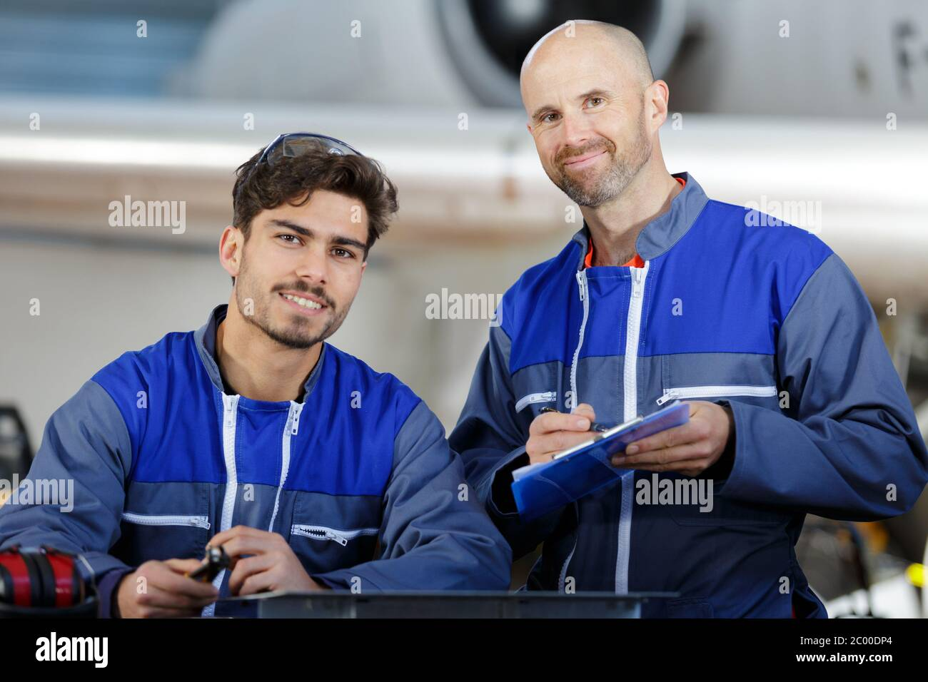 industrial manufacturing workers in factory Stock Photo