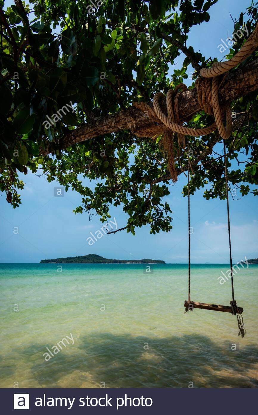 rustic rope swing in Long Beach on Koh Ta Kiev paradise island near Sihanoukville Cambodia Stock Photo