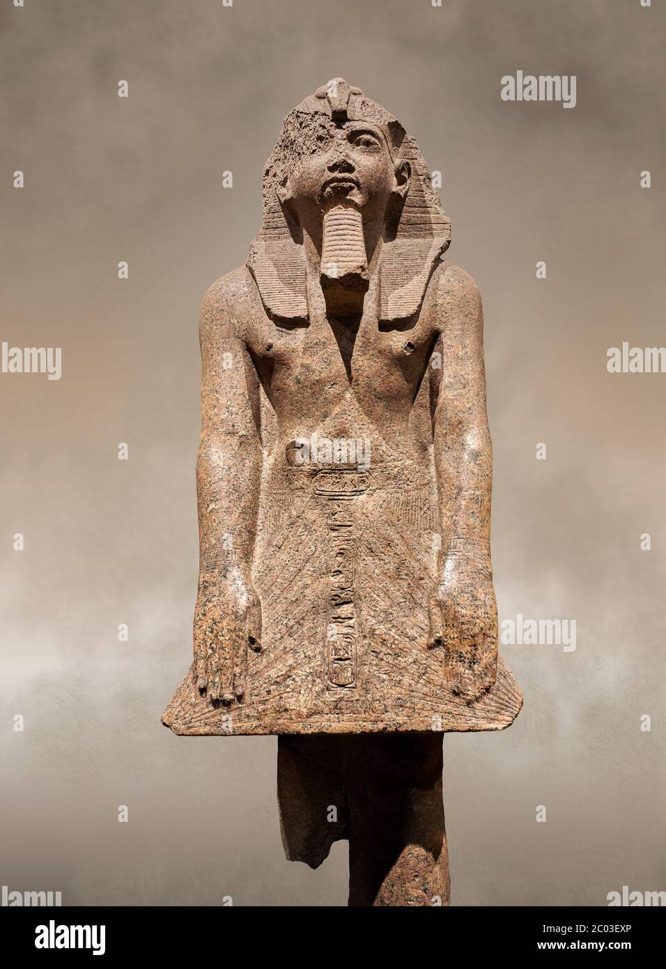 Ancient Egyptian statue of Ramesses II , granite, New Kingdom, 18th Dynasty, (1500-1400 BC, Karnak, Temple of Mut. Egyptian Museum, Turin. Grey backgr Stock Photo