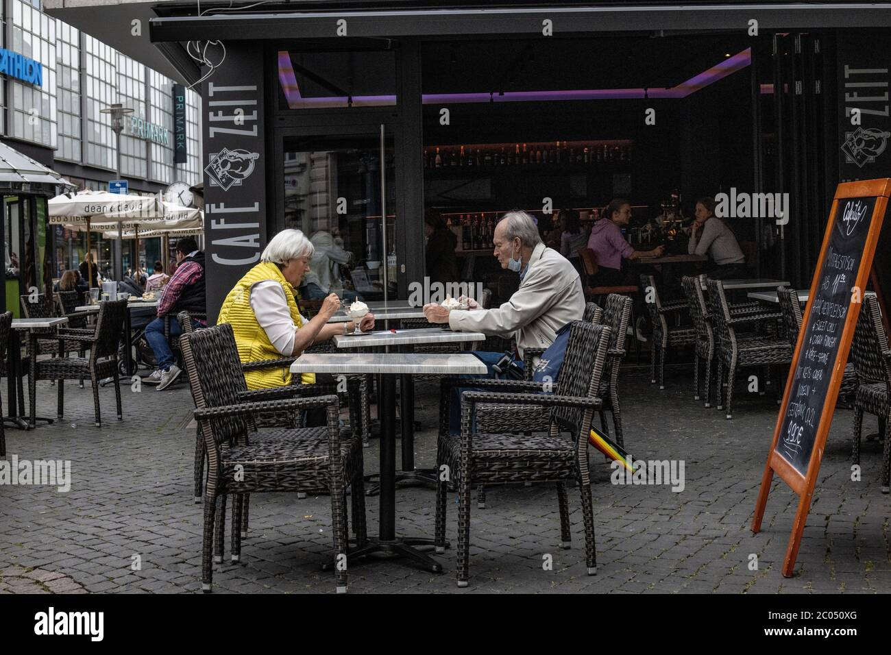 German people going about their everyday lives after the coronavirus lockdown restrictions are relaxed in Braunschweig, north-central Germany Stock Photo