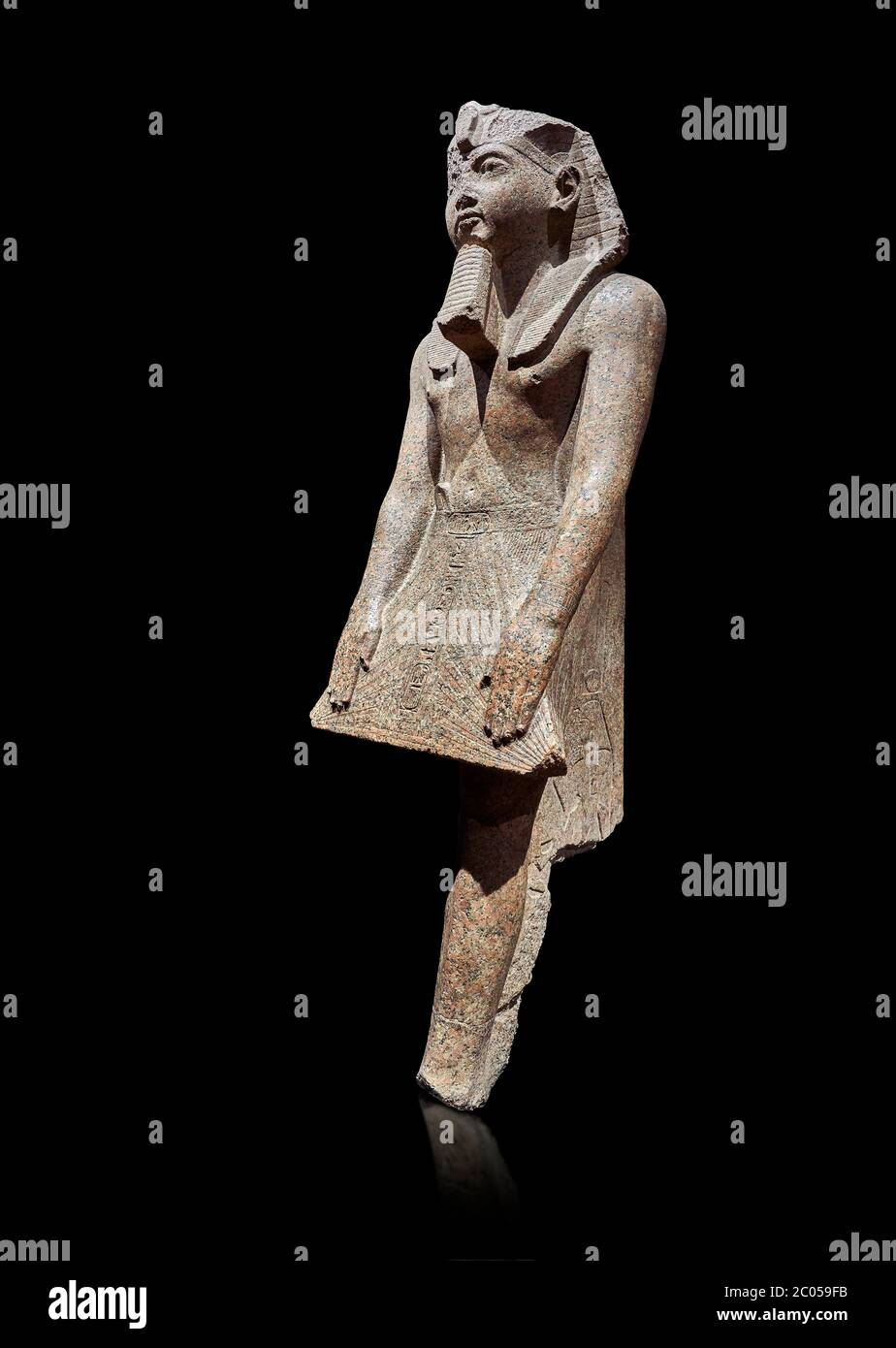 Ancient Egyptian statue of Ramesses II , granite, New Kingdom, 18th Dynasty, (1500-1400 BC, Karnak, Temple of Mut. Egyptian Museum, Turin. black backg Stock Photo