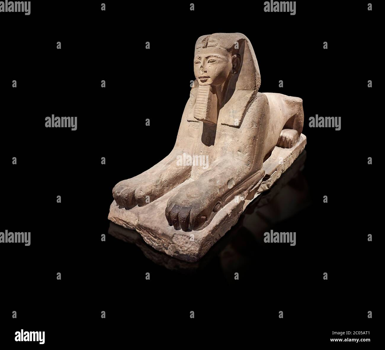 Ancient Egyptian Sphinx statue, sandstone, New Kingdom, early 19th Dynasty (1292-1250), Karnak, Temple of Amon. Egyptian Museum, Turin. black backgrou Stock Photo