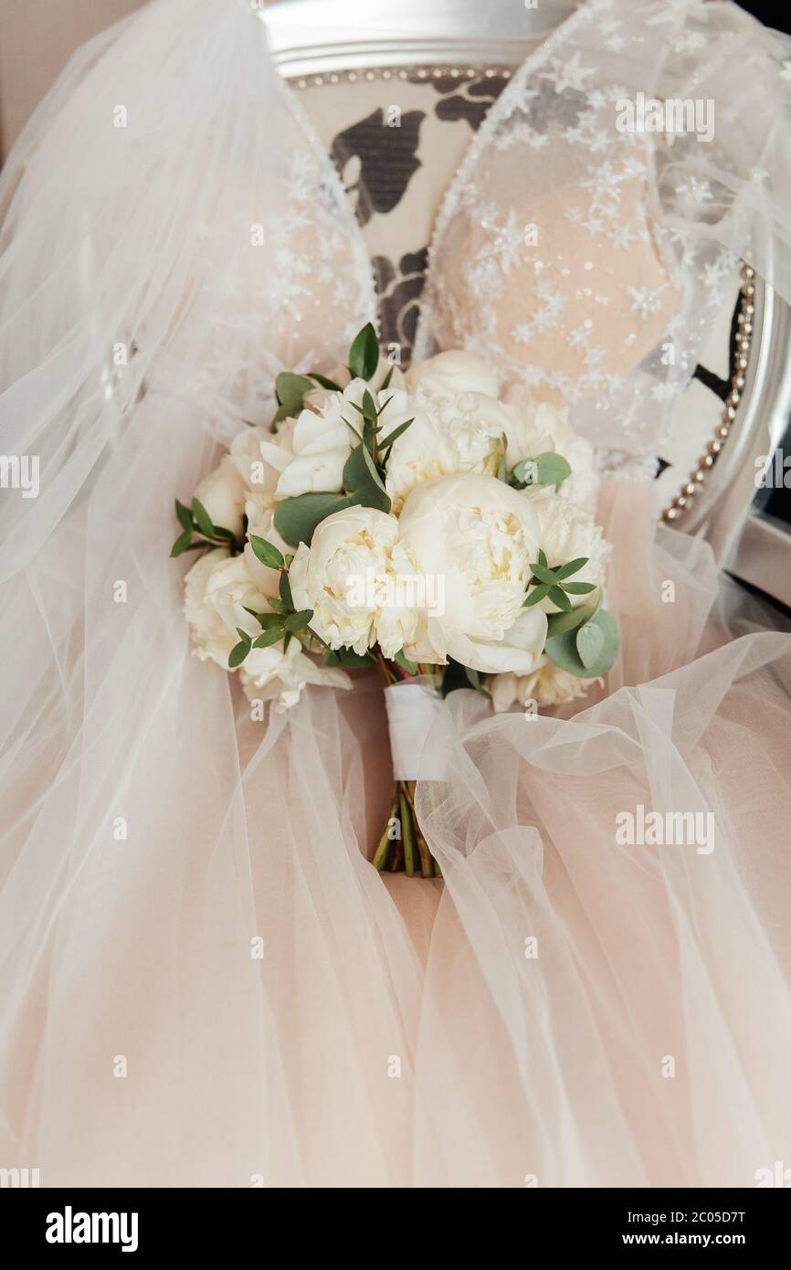 luxurious bouquet in the hands of the bride in a wedding dress and ...