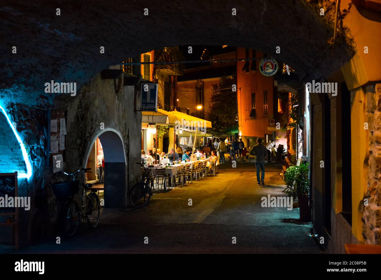 Late night in the village of Monterosso Al Mare, part of the Cinque Terre in Italy on the Italian Riviera as tourists enjoy an evening sidewalk cafe Stock Photo