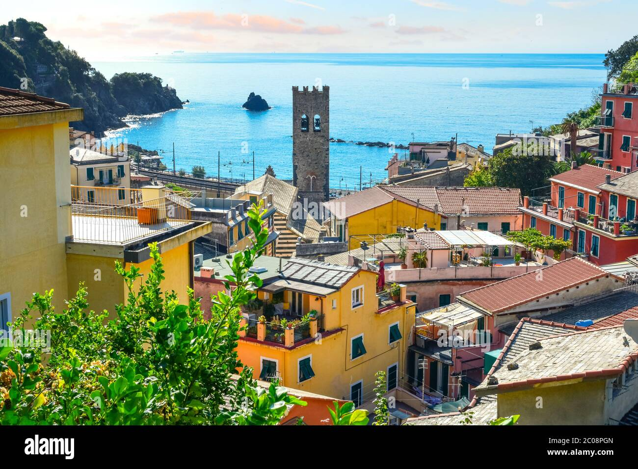 The blue Ligurian sea and coast from the town of Monterosso al Mare, on the Italian Riviera of Cinque Terre Italy with the church tower in view Stock Photo