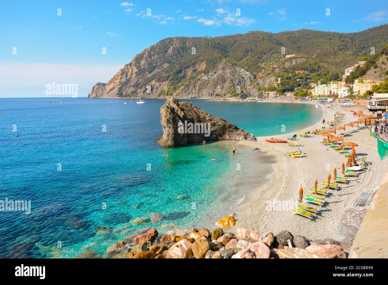The sandy beach at the Italian village of Monterosso al Mare on the Ligurian coast, part of the Cinque Terre, an Unesco World Heritage Site. Stock Photo