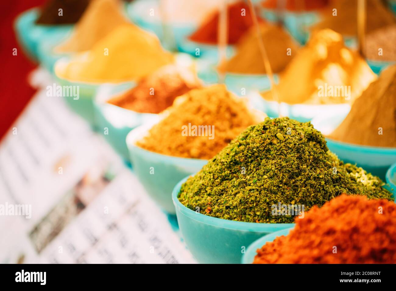 Close View Of Masala Curry, Bright Colors Fragrant Seasoning, Condiment In Tray On Local Food Market, Bazaar Stock Photo