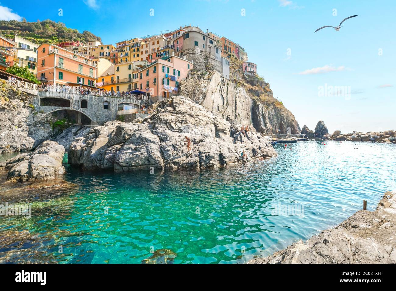 The turquoise bay and swimming area at the village of Manarola, one of the five villaged of the Cinque Terre, a World Heritage Site. Stock Photo