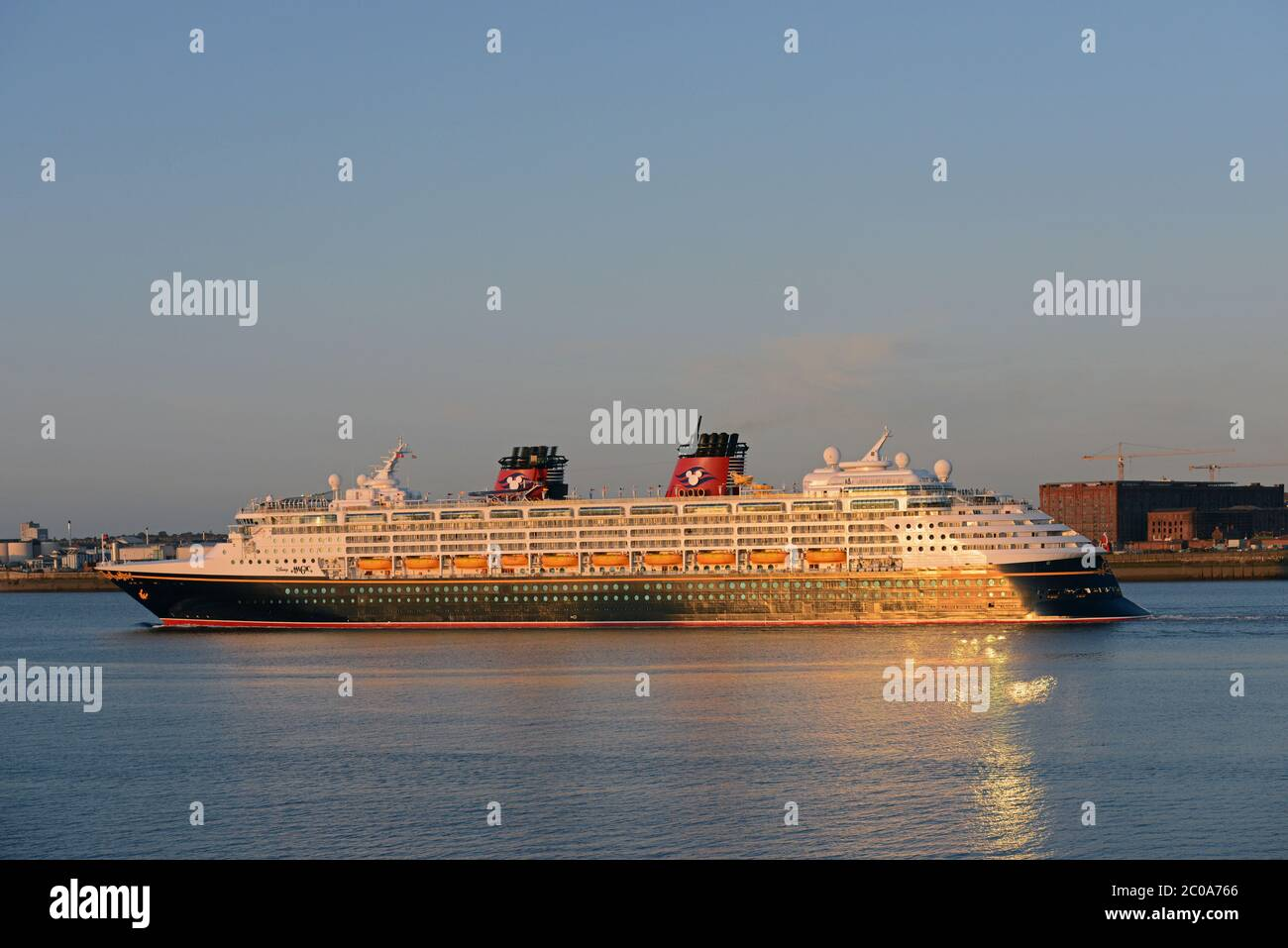 DISNEY MAGIC in the RIVER MERSEY at Liverpool passing the famous STANLEY DOCK building, LIVERPOOL, ENGLAND Stock Photo