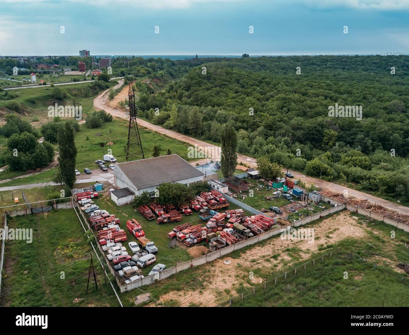 Old rusty broken Russian fire trucks for scrap metal, aerial view. Stock Photo