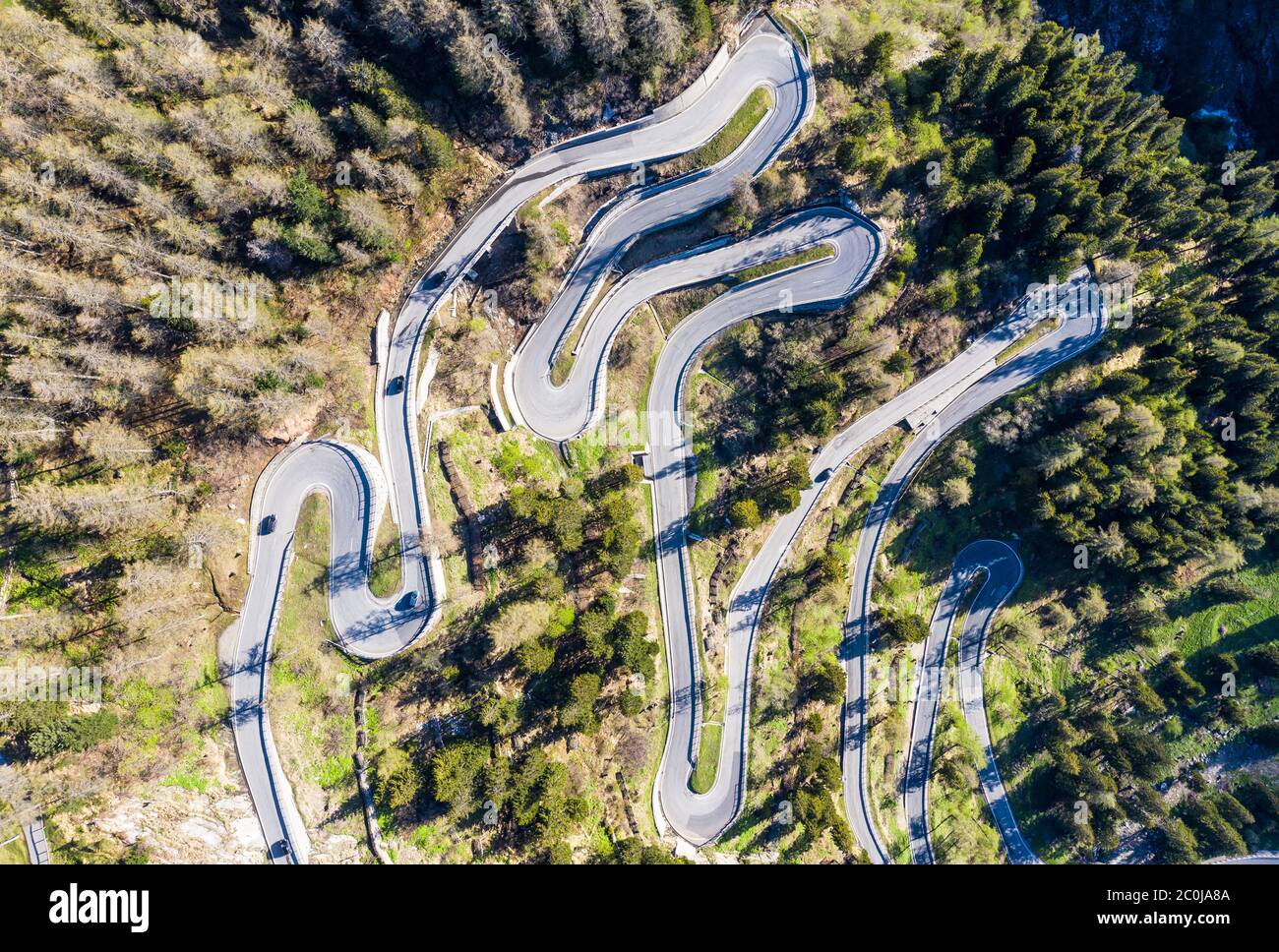 Top down view of the famous Maloja pass winding road in the alps in Canton Graubünden in Switzerland Stock Photo