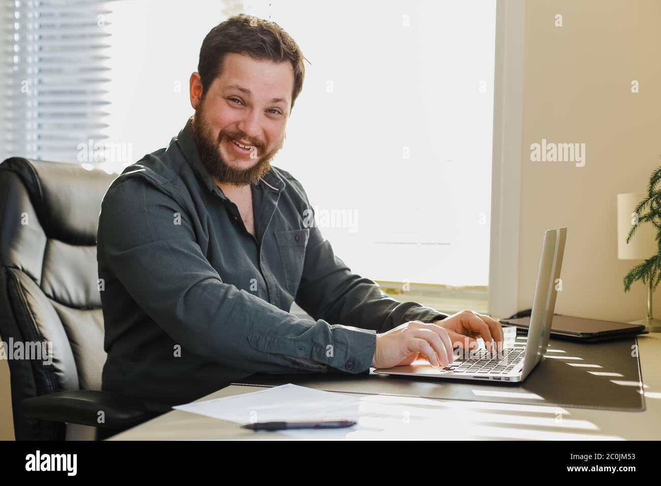 Web Developer Sitting At Office Desk Working On Laptop Computer Stock Photo Alamy