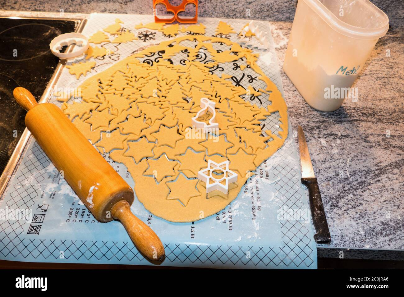 Christmas Biscuit Rolled Out And Biscuits Cut Out Ready To Bake With A Rolling Pin And Biscuit Cutters Stock Photo Alamy