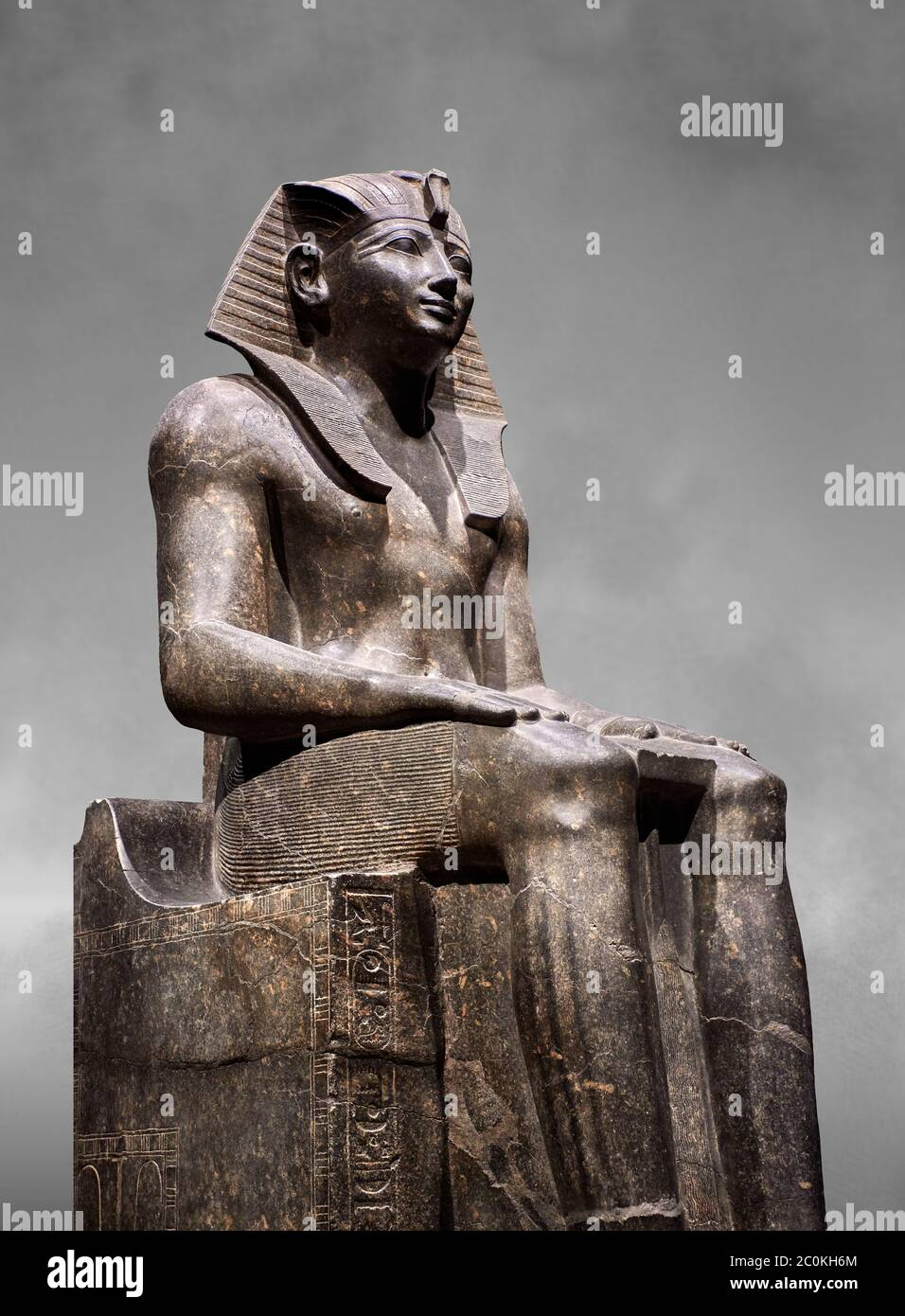 Ancient Egyptian statue of Tuthmosis II, granodorite, New Kingdom, 18th Dynasty, (1479-1425 BC), Karnak, Temple of Amun. Egyptian Museum, Turin. Grey Stock Photo