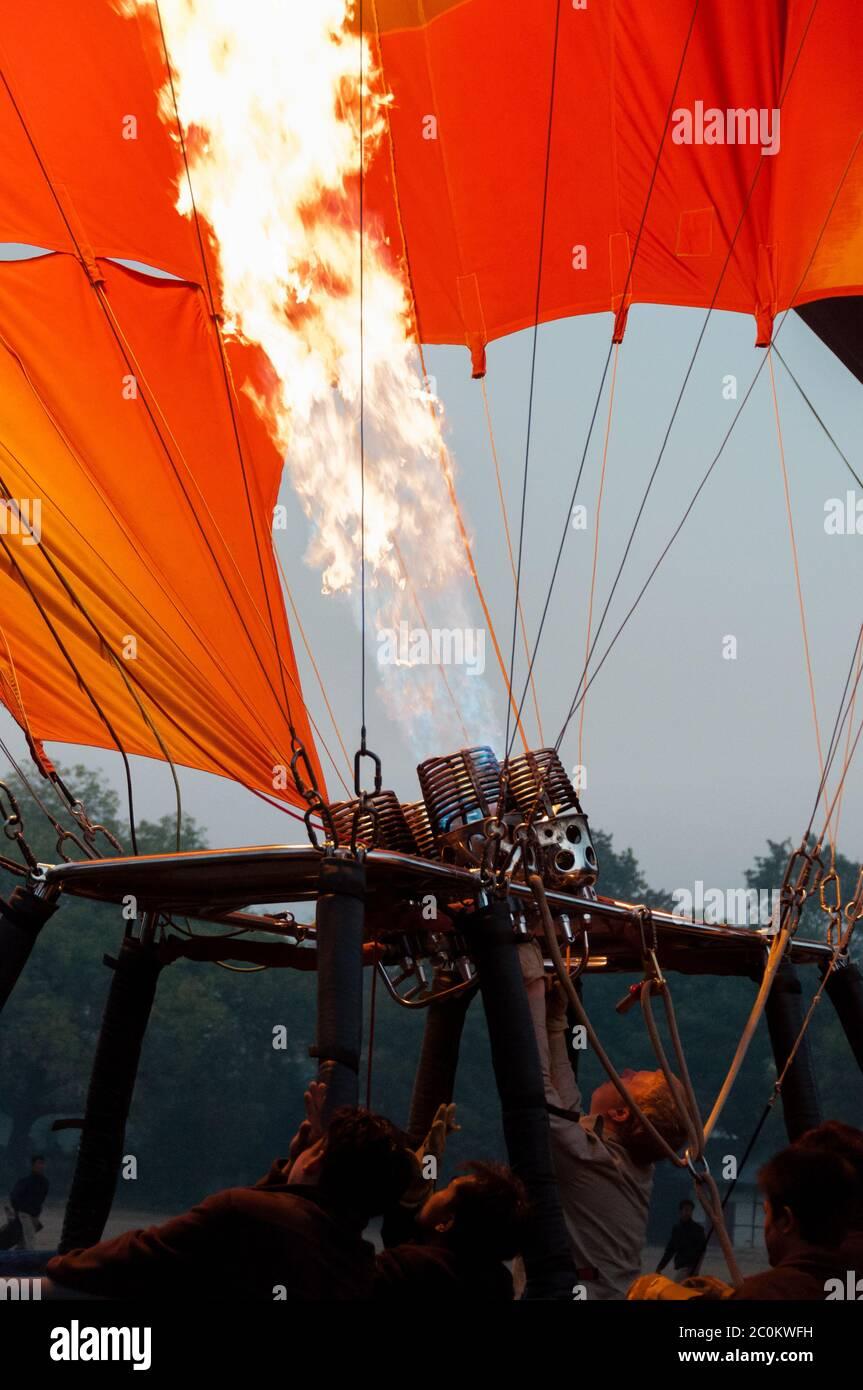 Hot air balloon crew starting fire Stock Photo