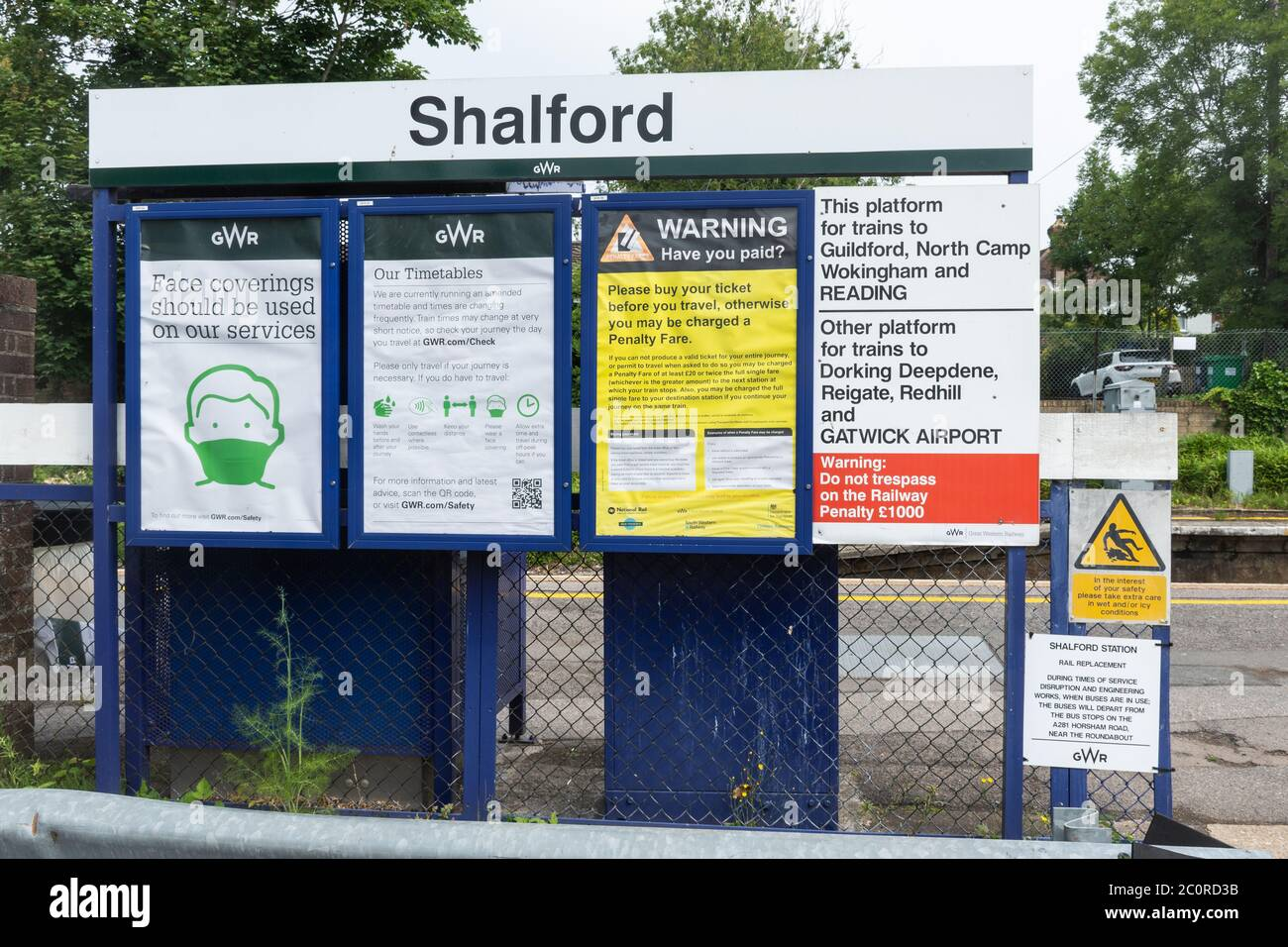 Notices at Shalford railway station informing passengers Face coverings should be used on trains during the 2020 coronavirus covid-19 pandemic, UK Stock Photo