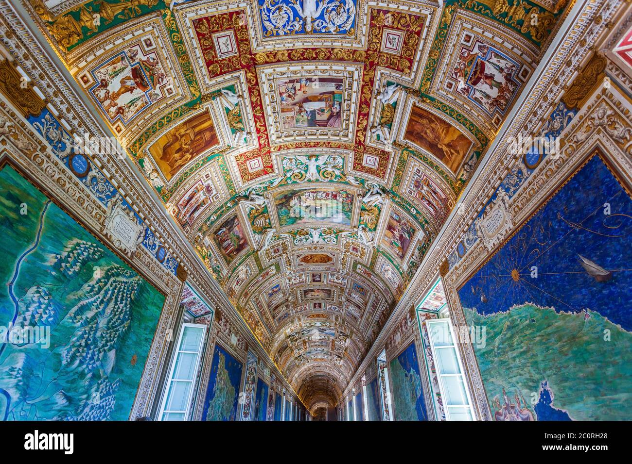 Rome, Italy - November 3, 2019: Paintings on the walls and the ceiling in the Gallery of Maps, at the Vatican Museum. Stock Photo