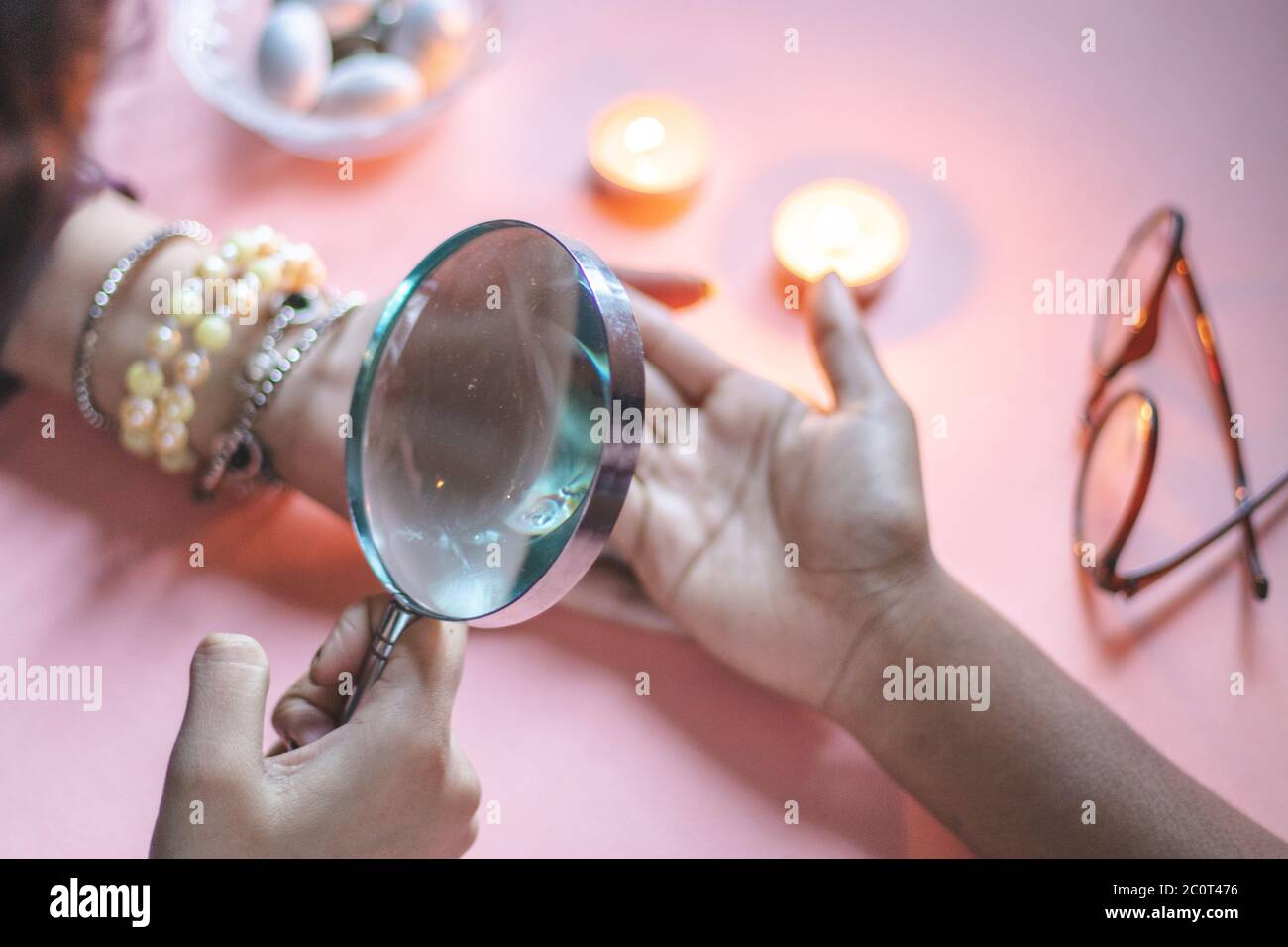 palmistry fortune teller reads lines on hand or palm to tell future. Stock Photo