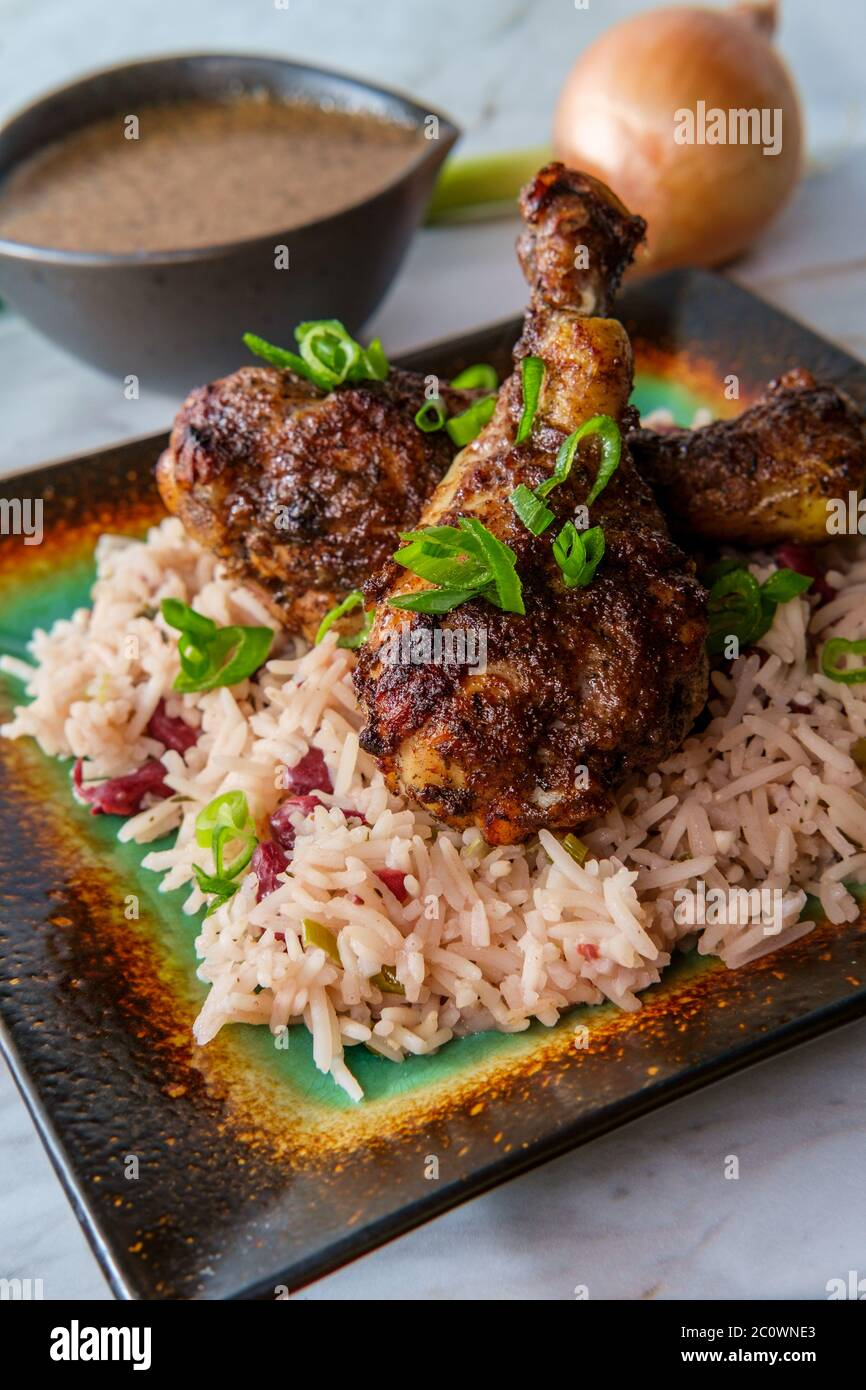 Authentic Spicy Jamaican Jerk Chicken Legs With Scotch Bonnet Chili Peppers Served With Coconut Rice And Peas Stock Photo Alamy