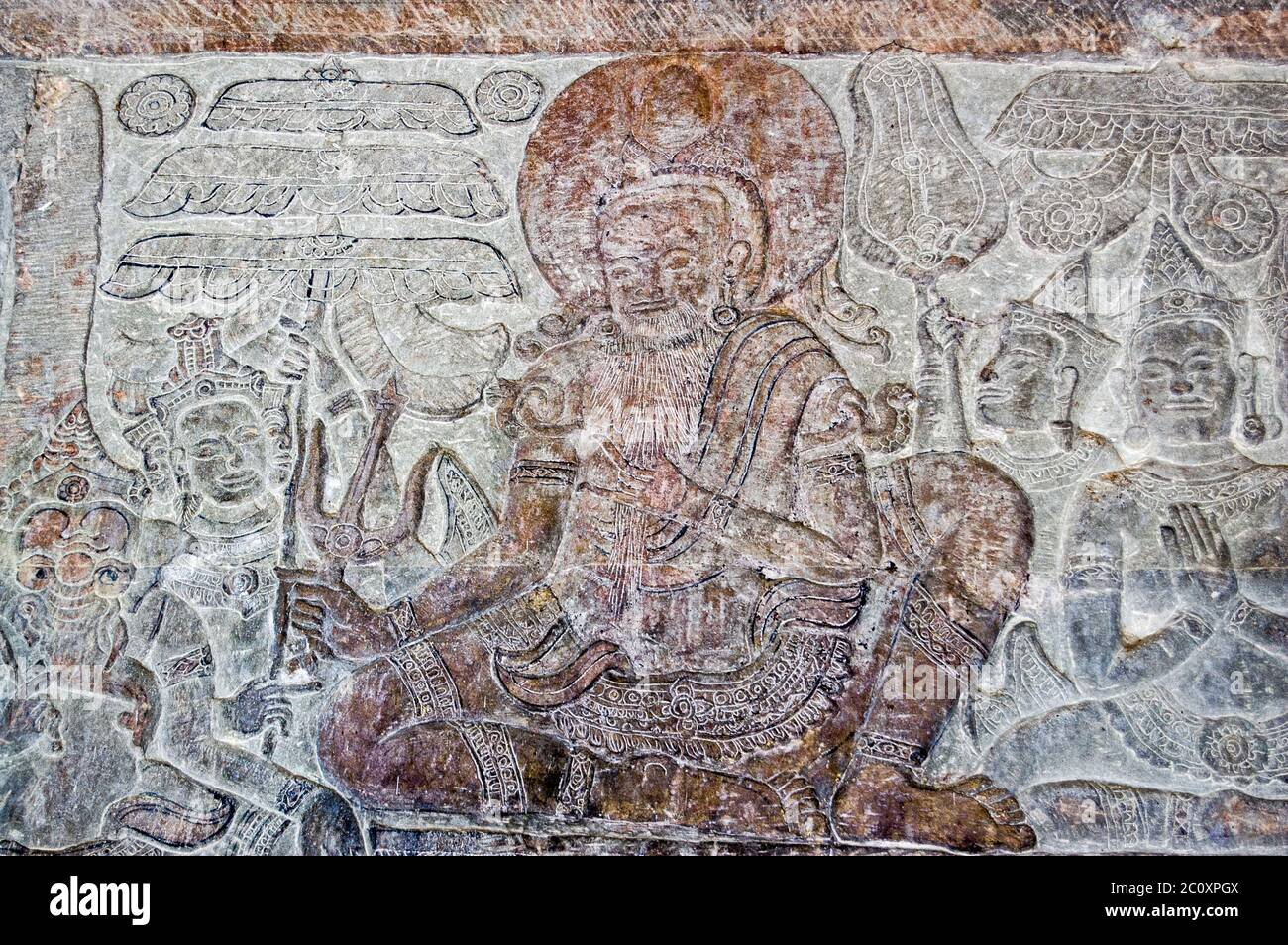 Bas relief carving of a old man on the wall of Angkor Wat temple in Siem Reap, Cambodia. Stock Photo