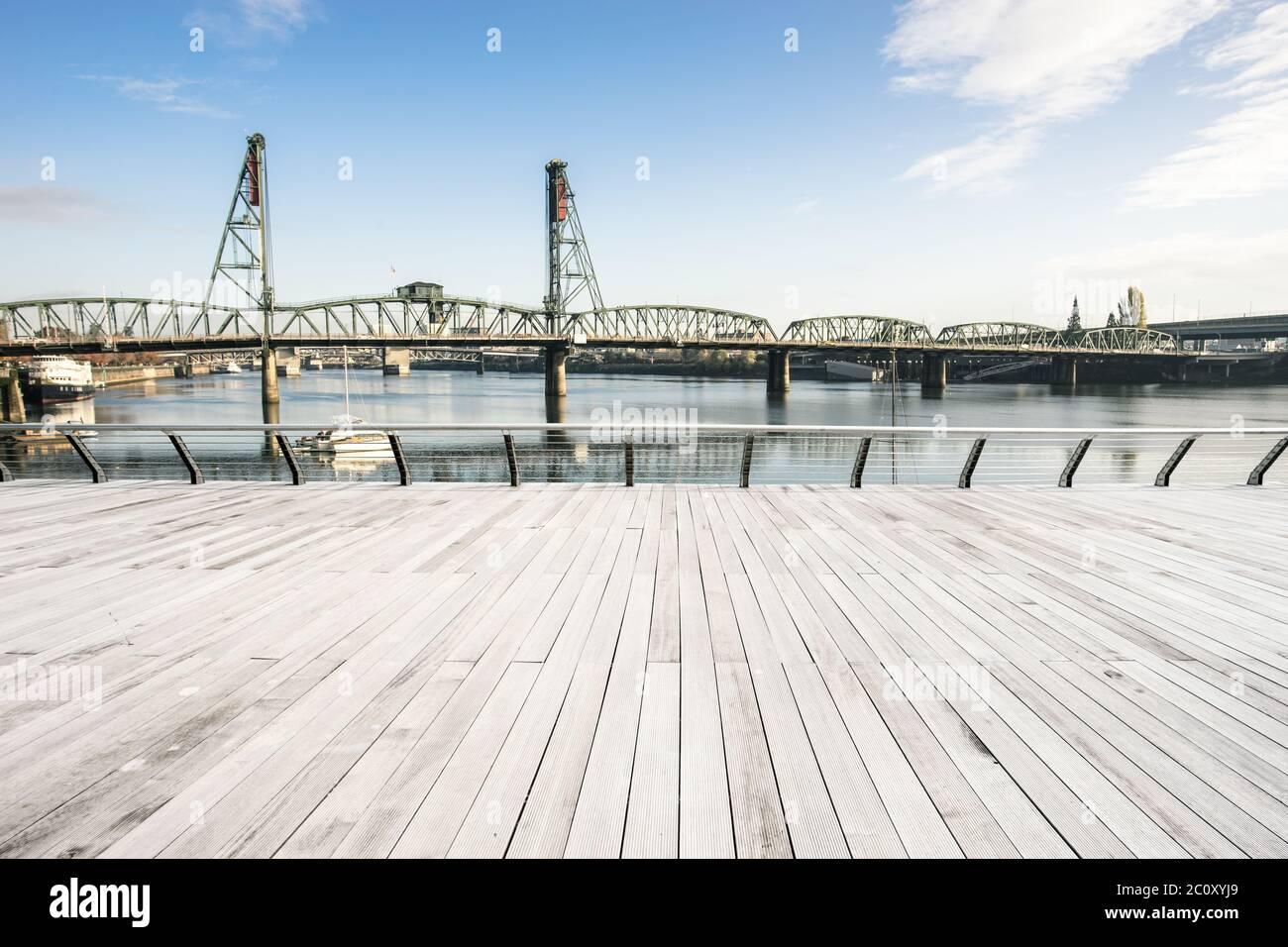 empty wood floor with steel bridge over sea in portland Stock Photo