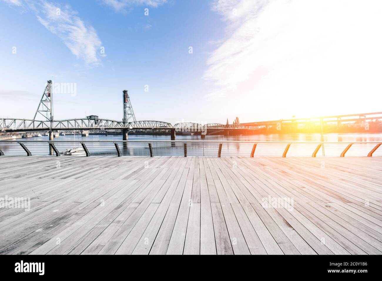 empty wood floor and bridge over water at sunrise in portland Stock Photo