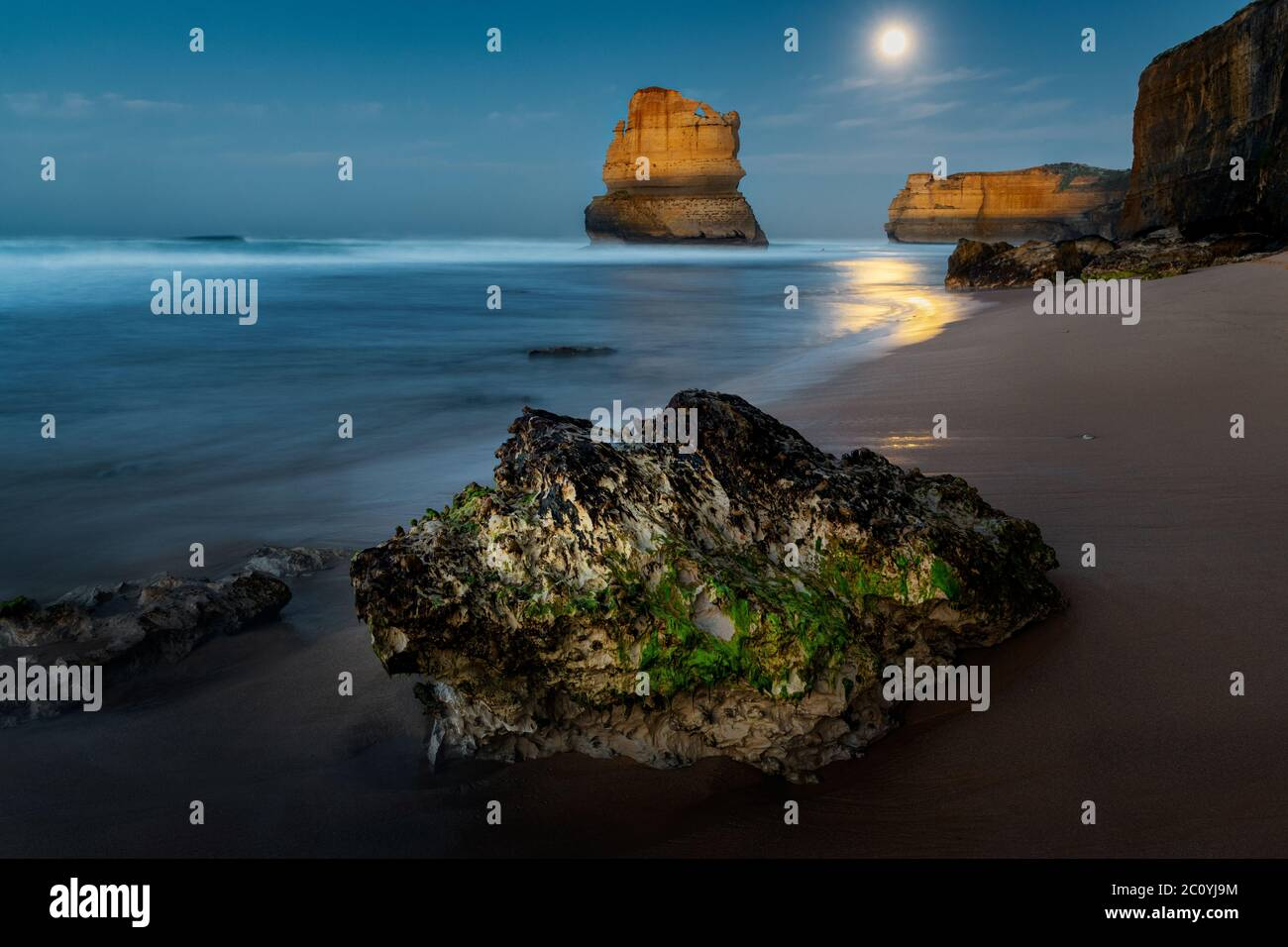 Day is dawning after a full moon night at the famous Great Ocean Road. Stock Photo