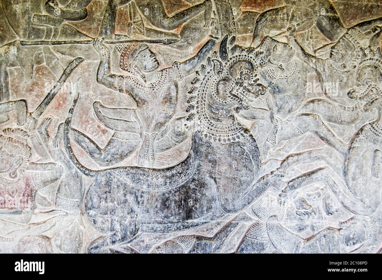 Ancient Khmer carving of a Hindu god riding into battle on the back of an imperial lion. Bas relief frieze on a wall of Angkor Wat Temple, Siem Reap, Stock Photo