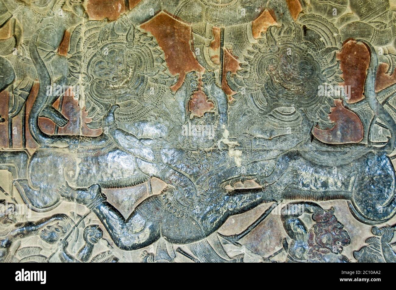 The Hindu monkey god Hanuman fighting two imperial lions in the Battle of Lanka. Wall of Angkor Wat temple, Angkor, Siem Reap, Cambodia. Stock Photo