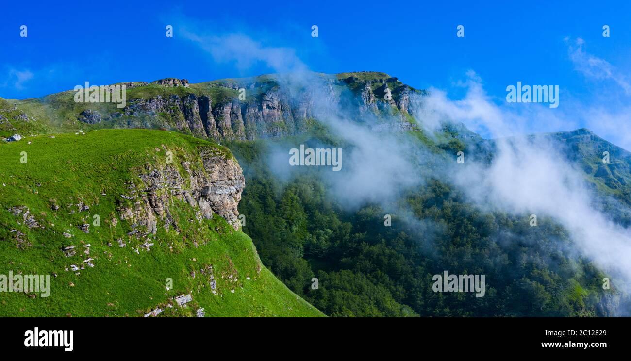 Spring landscape of mountains and meadows near the Portillo de Lunada in the Valle del Miera, Cantabria, Spain, Europe Stock Photo