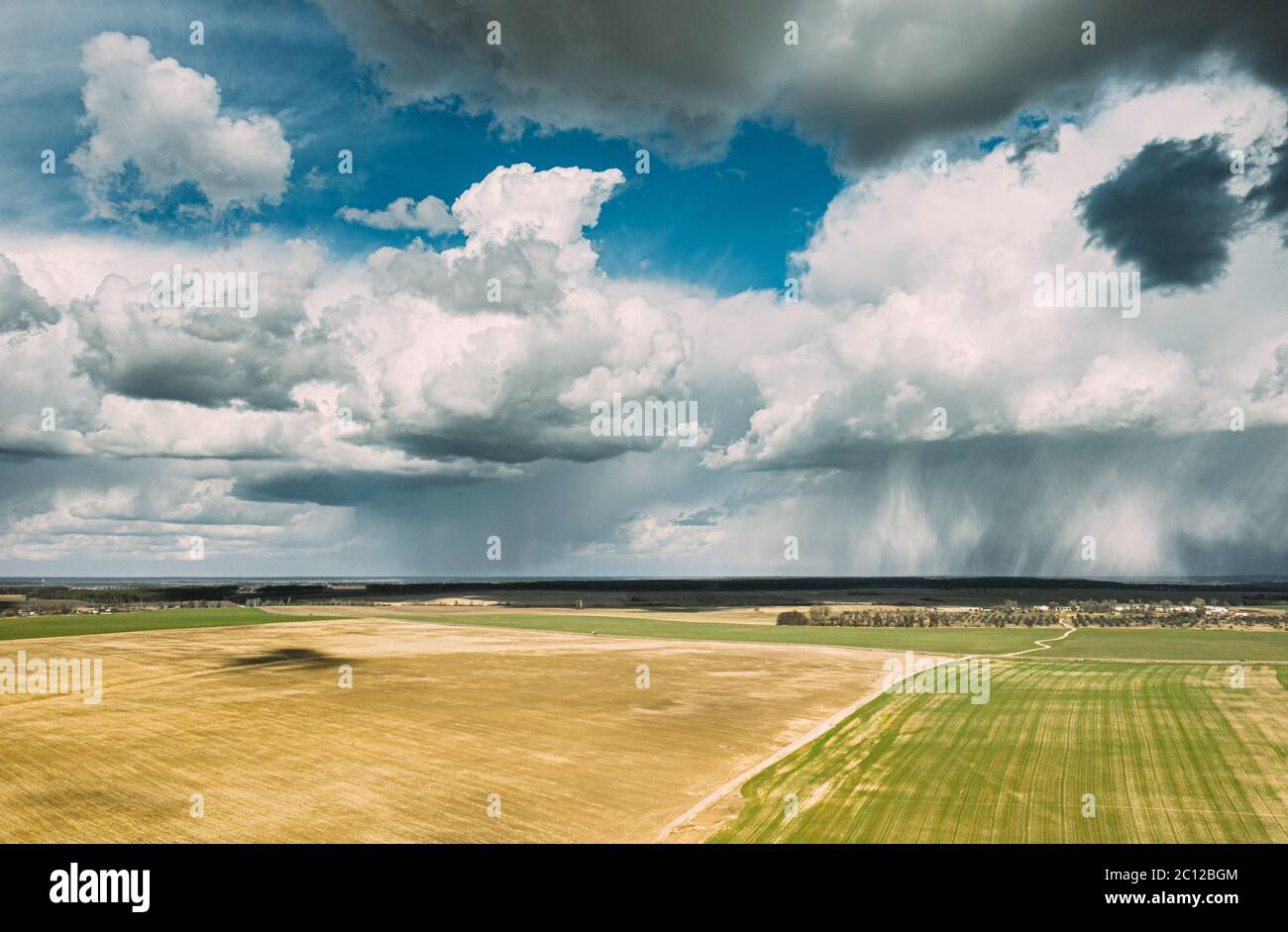 Aerial View. Amazing Natural Dramatic Sky With Rain Clouds Above Countryside Rural Field Landscape In Spring Summer Cloudy Day. Scenic Sky With Fluffy Stock Photo