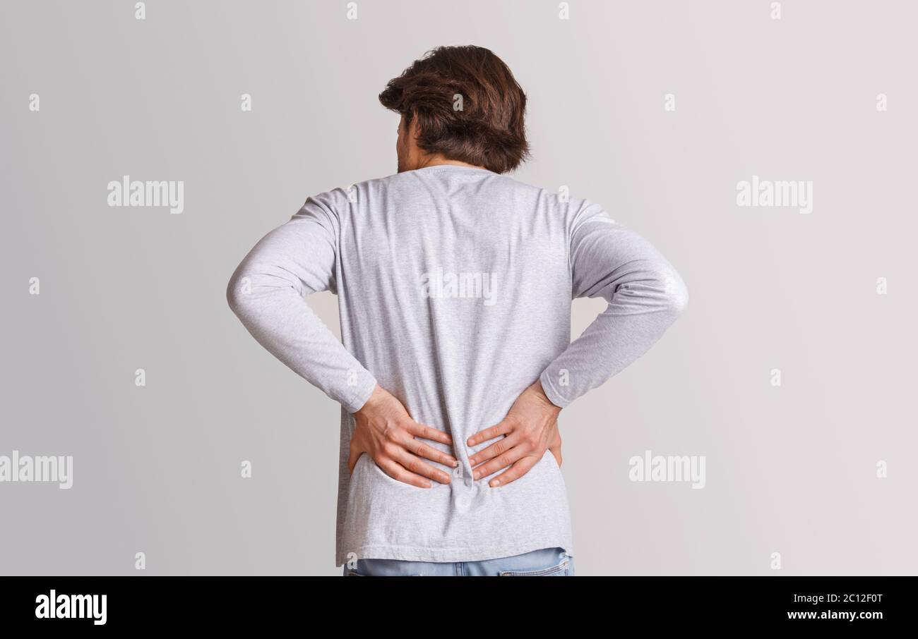 Body Ache And Kidneys Pain Man Presses His Hands To Back Stock Photo Alamy