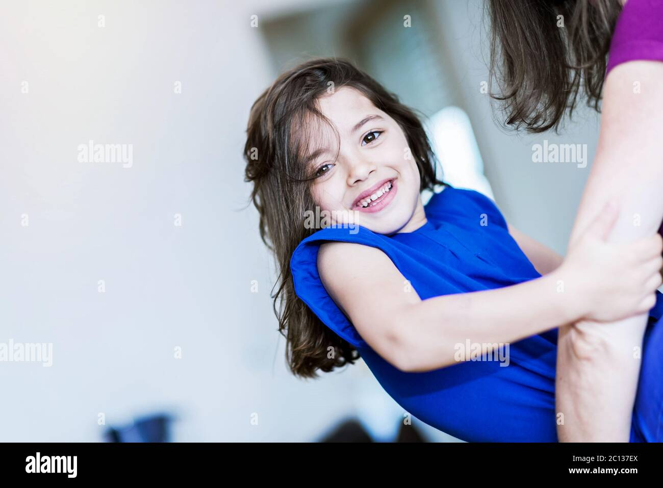 complicity between a very cute little girl and her mother Stock Photo