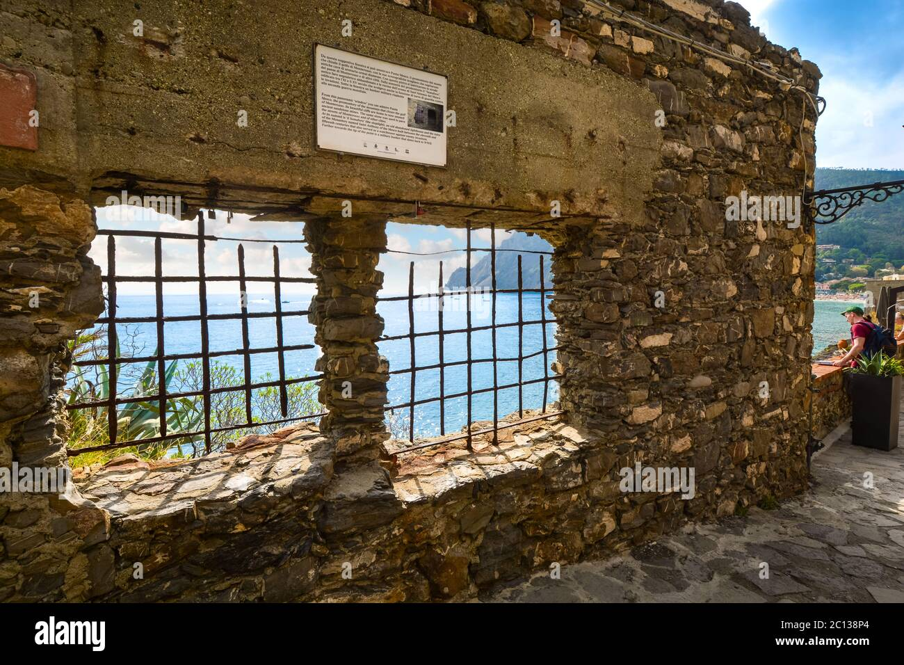 Tourists stop to enjoy the view of the Ligurian Sea on the walking path between the old and new sections of Monterosso Al Mare, Cinque Terre, Italy Stock Photo
