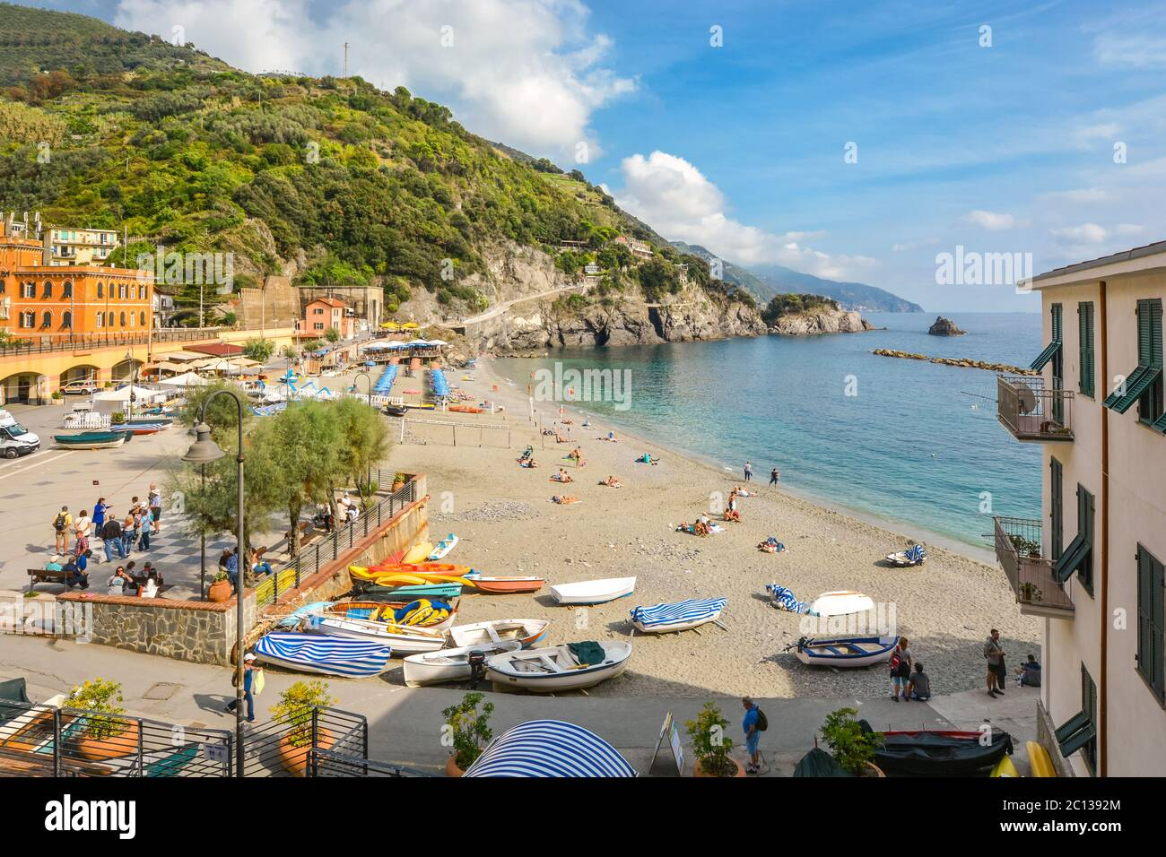 Sandy beach and clear blue water on the old side of the village of Monterosso Al Mare on the Ligurian coast of Cinque Terre, Italy. Stock Photo