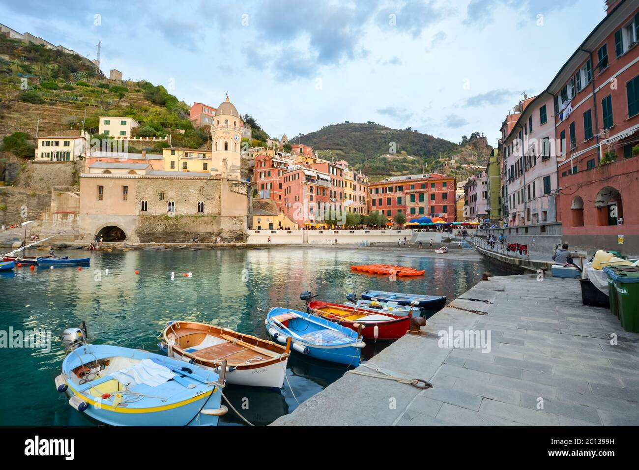 Boats line the small harbor of the colorful, picturesque village of Vernazza, Italy, one of the Cinque Terre villages in the Ligurian area of Italy. Stock Photo